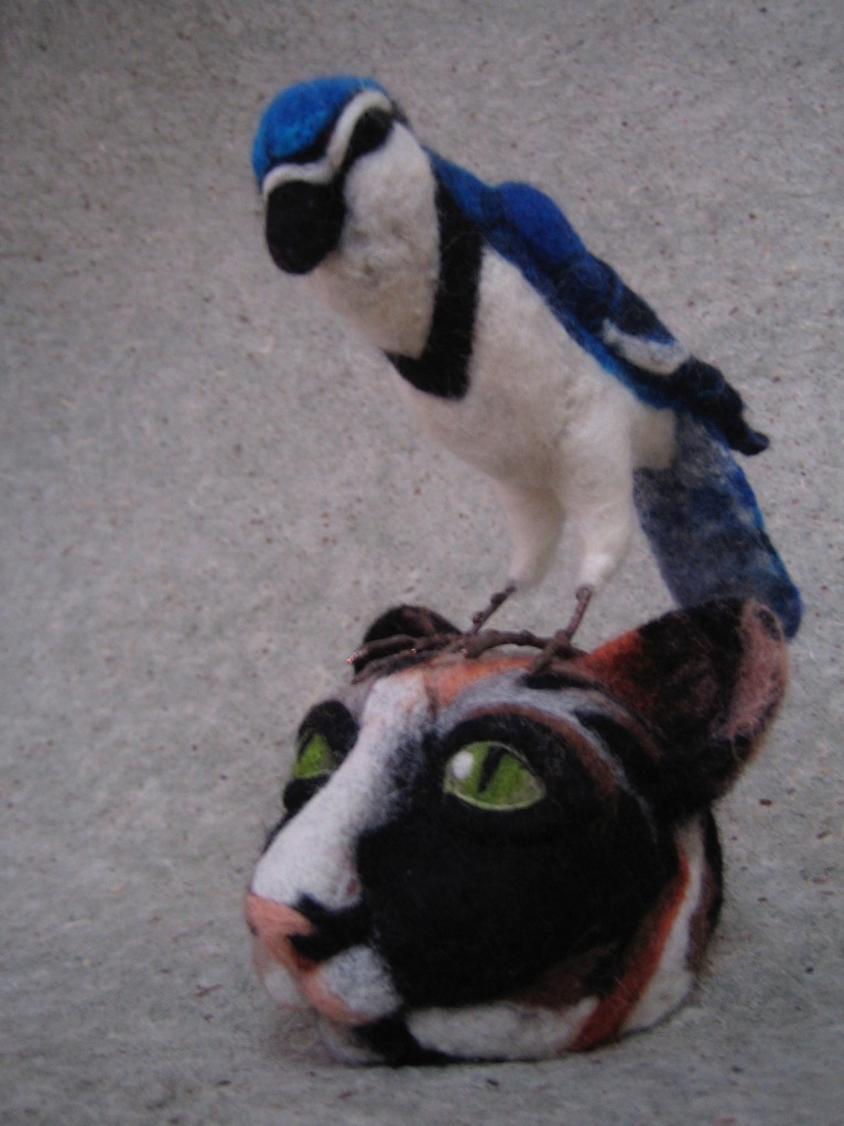 felted callico cat head with Blue Jay.