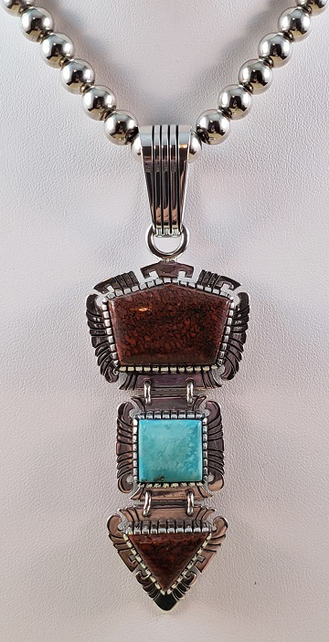 Click to read the amazing story behind this unique pendant!