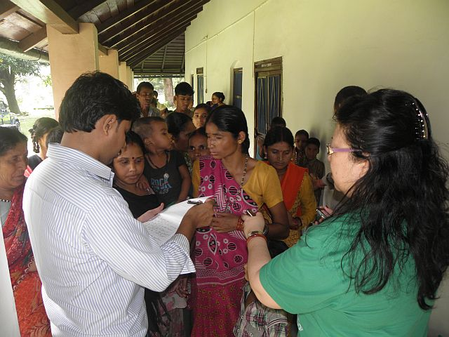 Mrs. Rina Khatau, Co-Chairman of The Corbett Foundation, distributing flood relief