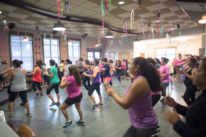 A group of women in a zumba class.