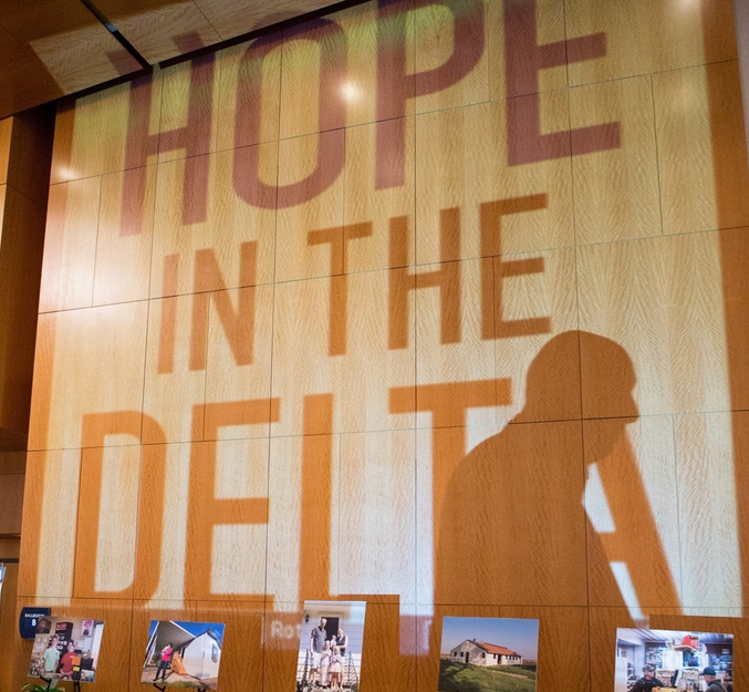 Photograph of a projection with text that reads: Hope in the Delta