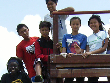 A group of kids pose on a playground