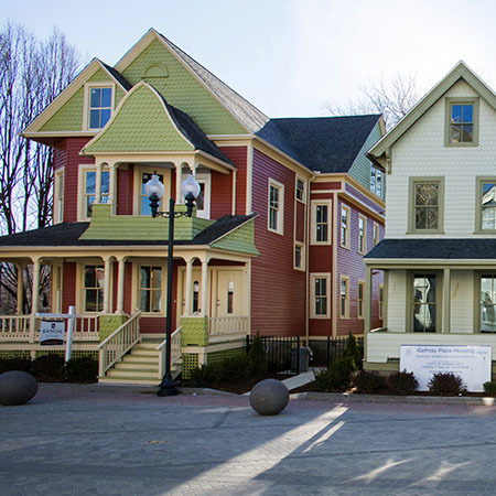 Two renovated, brightly-painted homes
