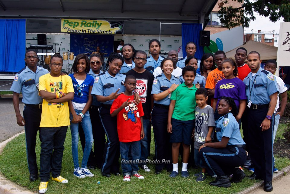 Group of young people and police officers