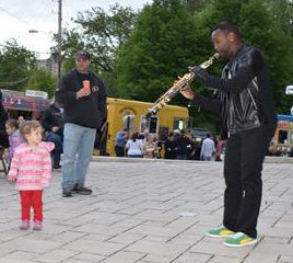 A man playing an instrument outside