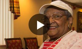 A video still of Janet Simmons, an elderly black woman