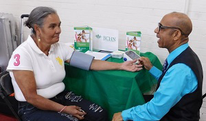 BCHN's Pedro Gonzalez checks the blood pressure of a patient at Highbridge Community Church.