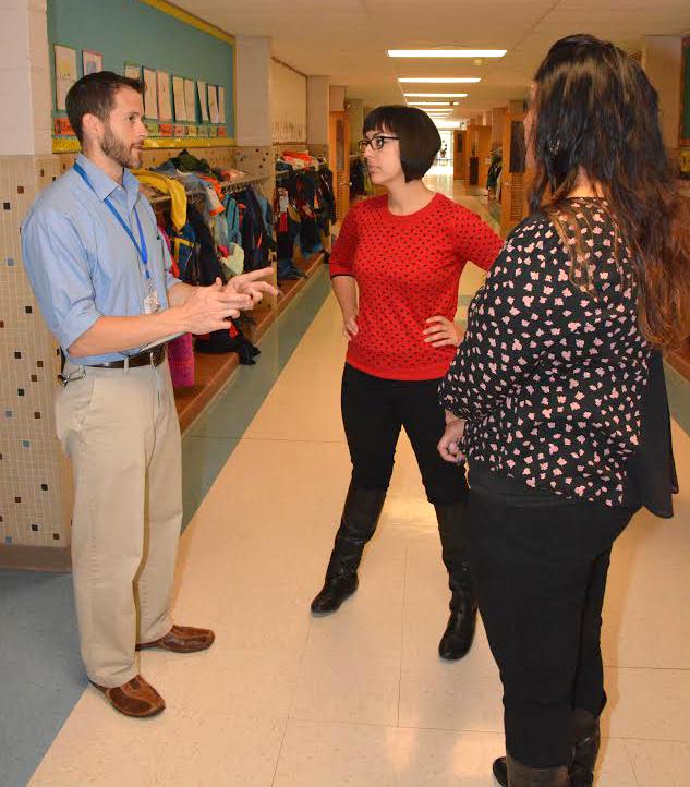 Staff meeting in a hallway