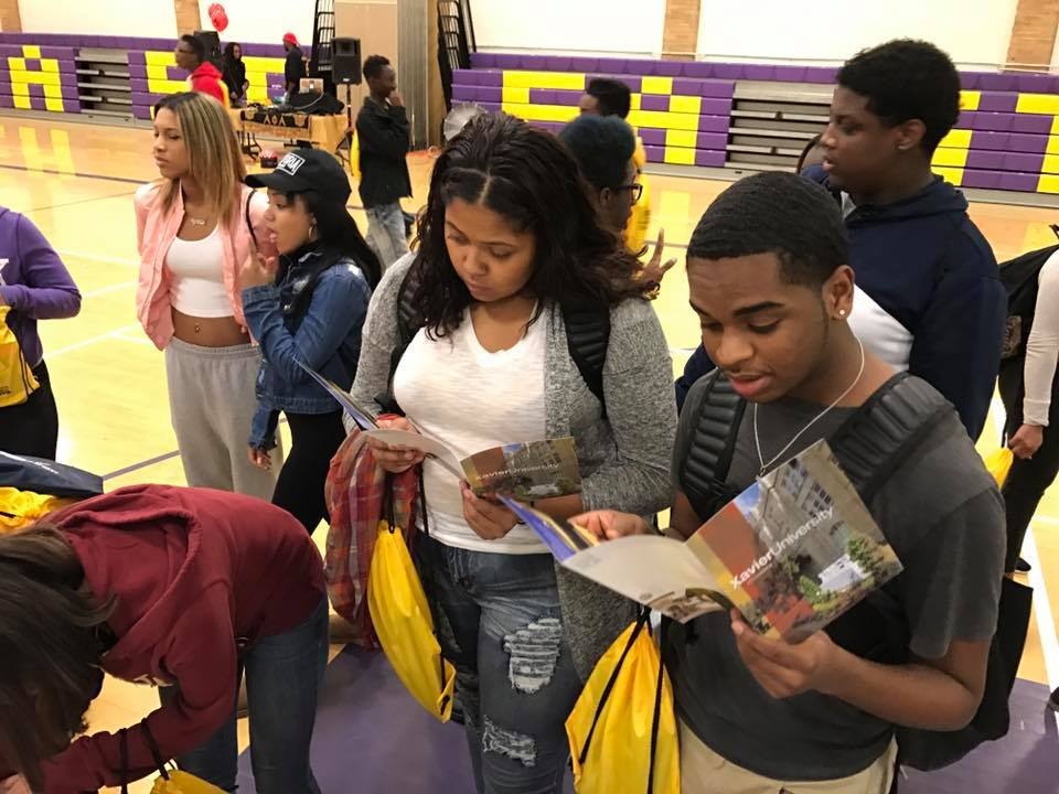 Students reading about colleges. This links to the cap times article.