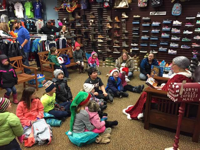 Image of children listening to story from Mrs. Claus (Bottineau, ND)