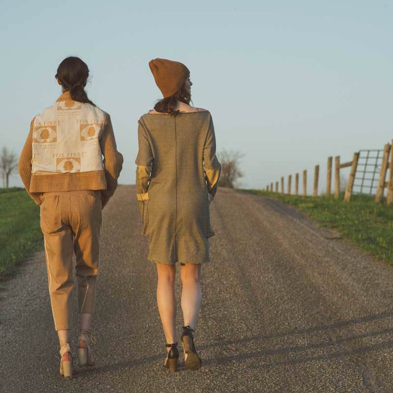 Models walking on a gravel lane.