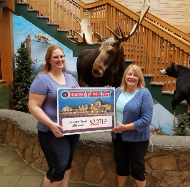 Natalie Barrett, buyer's assistant and conservation committee member presented a check to ETA's President, Deb Erickson-Irons for $2271.25!