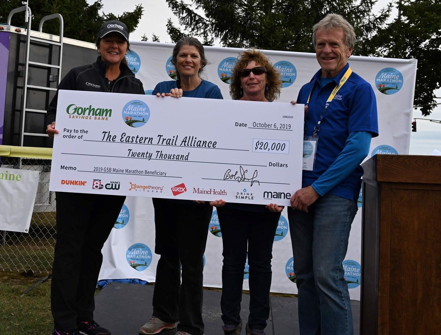 Maine Marathon presents check for $20,000 to ETA