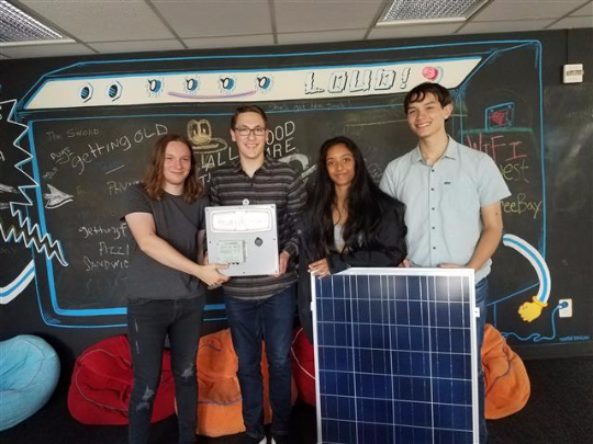 Students from Catlin Gabel and their solar powered charging stations
