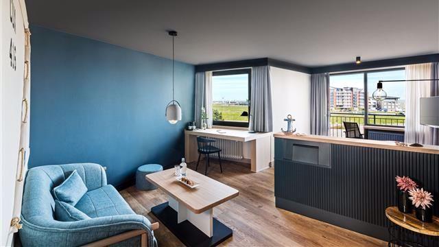 Wohn- & Schlafbereich von einem Deluxe-Doppelzimmer